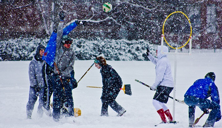 Students in the MSU Quidditch club playing outside in the snow.
